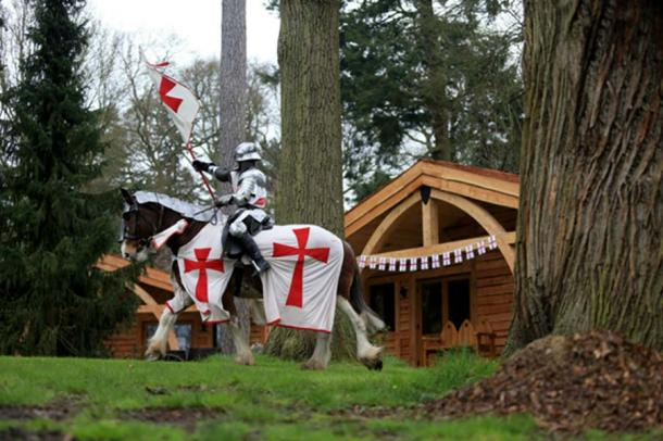 A knight on horseback passing a lodge. ((Warwick-castle.com)