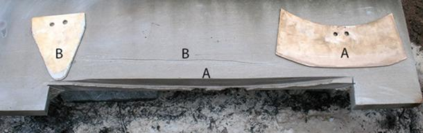 A limestone block displays a curved, Mycenaean-style cut made by a curved blade, A, and a shallow, wobbly incision made by a triangular blade, B. (N. Blackwell/Antiquity 2018)