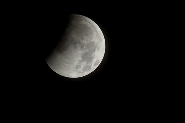 A lunar eclipse begins in Virginia, USA, December 21, 2010.