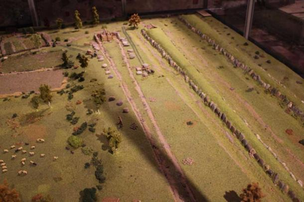A model of neolithic village and burial site – megalithic tombs under construction. (Image: Krzysztof Gorczyca, Konin Museum)
