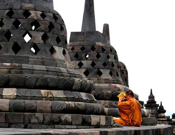 A monk prays at Borobudur.