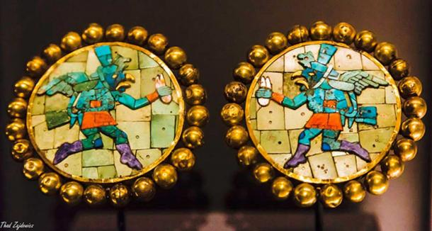 A pair of ear ornaments from Peru (Moche), ca. AD 200-600 Gold; shell; stome (turquoise or malachite) The Getty Center in Los Angeles, California.
