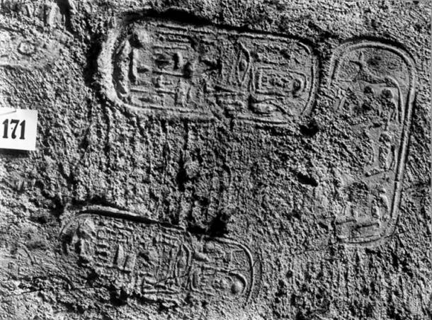 A portion of the first doorway of KV62, showing the seal of the Royal Necropolis - the jackal over nine captives - and Tutankhamun's name. (Public Domain: Harry Burton. Griffith Institute, Oxford)