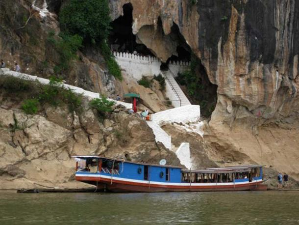 A river boat moors at the entrance to the Pak Ou Caves near Luang Prabang, Laos. Stephen Johnson/AAP