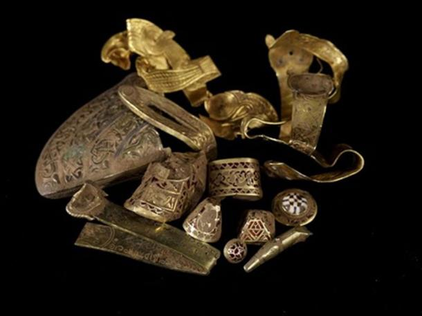 A selection of highlight pieces from the Staffordshire Hoard (top) and a gold sword hilt fitting with cloisonné garnet inlay, uncleaned by conservators, still showing traces of soil. (Staffordshire hoard / CC BY-SA 2.0)
