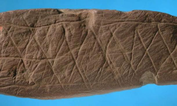 A similar pattern was engraved on this piece of ocher found at Blombos Cave in the same archaeological stratum that yielded the silcrete flake. (Image: D'Errico/Henshilwood/Nature)
