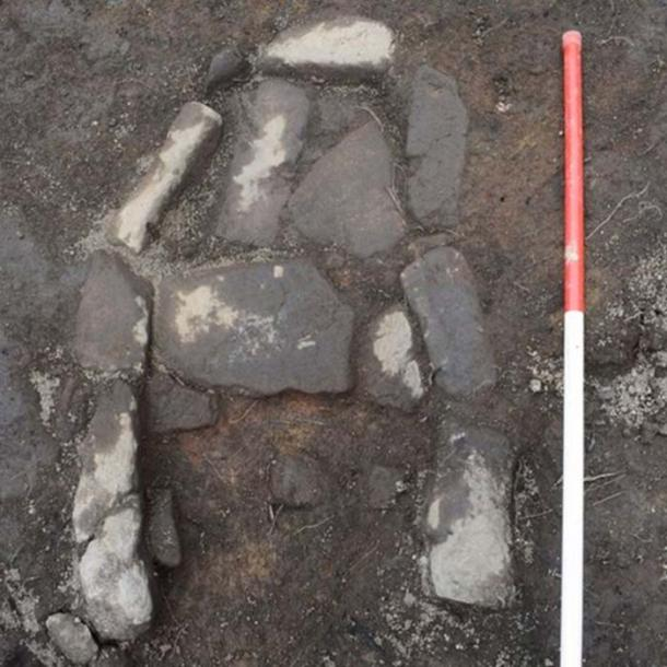 A stone hearth was one of the archaeological features uncovered during excavations.