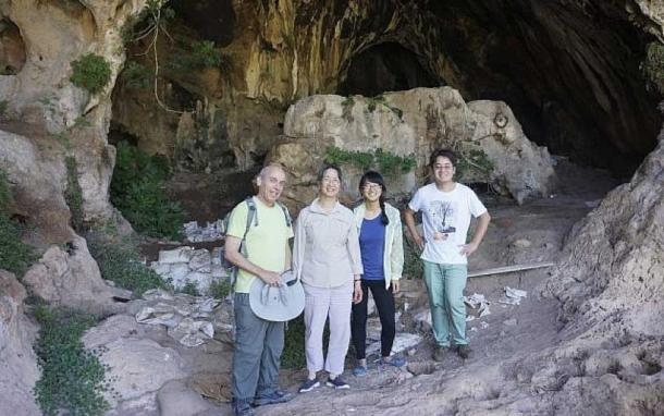A team of Stanford University and Israeli archaeologists stand in the entrance to Raqefet Cave, where they found evidence for the oldest man-made alcohol in the world. From left, Dani Nadel, Li Liu, Jiajing Wang and Hao Zhao. (Image credit: Li Liu)