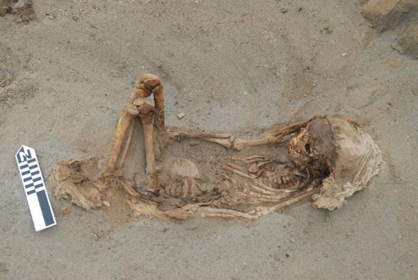 A typical child burial laying on its back with the legs flexed and cloth over the head. (© 2019 Gabriel Prieto et al / Plos ONE)
