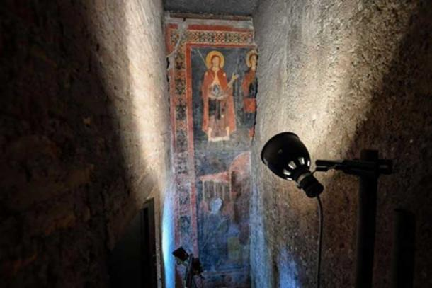 A wall had been placed over part of the medieval fresco during restoration works. (Il Messaggero)