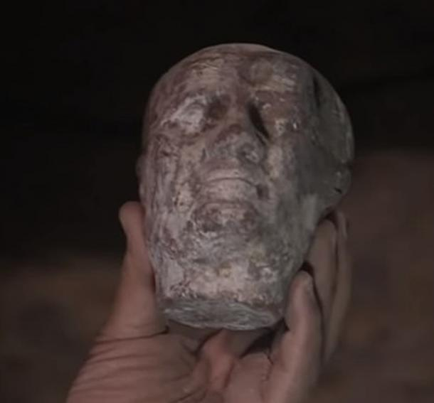 A wax head was the first item to be found in the sarcophagus. (© Discovery Inc.)