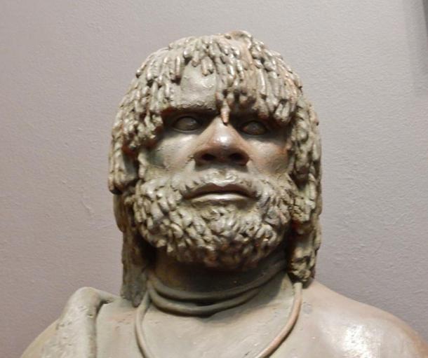 Sculpture of an Aboriginal Australian man.