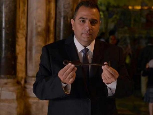 Adeeb Joudeh, the current custodian, with the key.