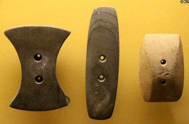 Adena culture gorget ornaments always two holes at Grave Creek Mound Museum. Moundsville, WV. Representative image