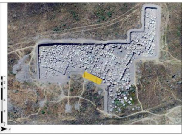 Aerial shot of the excavation area shown, including the Storm God Temple and the Bronze Age mosaic are (highlighted in yellow). (Usa̧klı Höyük Archaeological Project)