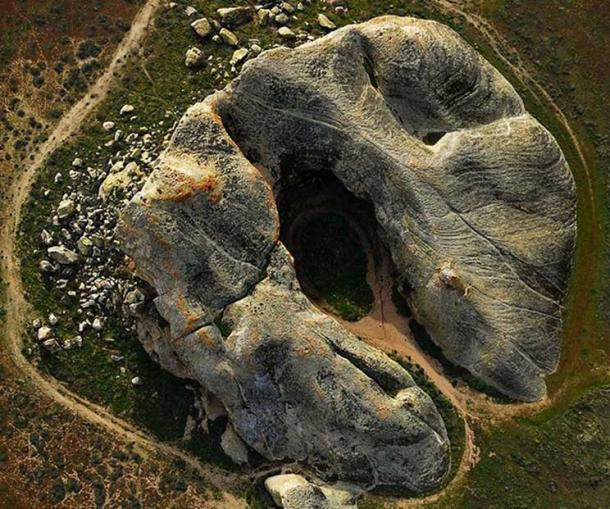 Aerial view of Painted Rock. The interior alcove of the horseshoe-shaped rock features pictographs by Chumash, neighboring tribes, and non-Native Americans.