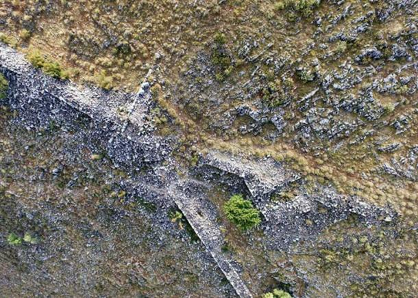 Aerial view showing the outline of fortress walls, towers, and city gates.