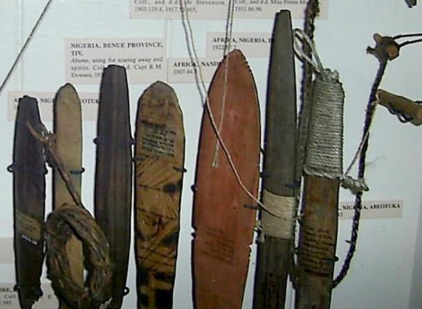 Seven variations of African bullroarers on display at the Pitt Rivers Museum, Oxford.