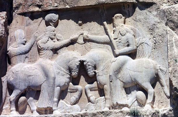 Ahura Mazda (on the right, with high crown) presents Ardashir I (left).