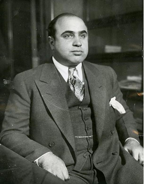 Al Capone is shown here in 1930 at the Chicago Detective bureau following his arrest on a vagrancy charge