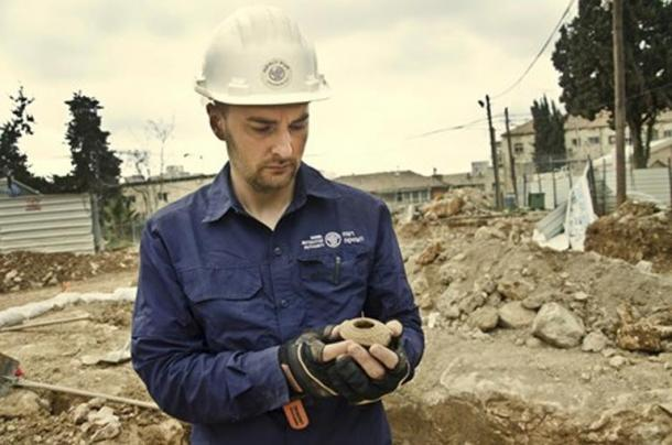 Excavation director Alex Wiegmann with oil lamp.
