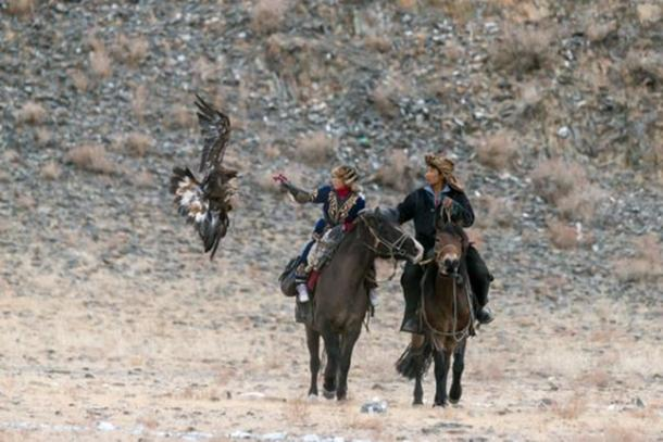 FIG 2.9. Amanbol and Bazarbai, brother and sister eagle hunters, 2014.