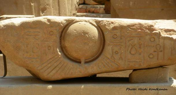 An Amarna period block displays a deeply-engraved relief of the radiant sun disc, the Aten, whose introduction as the sole god by Pharaoh Akhenaten changed the course of Egyptian history. Luxor Temple.