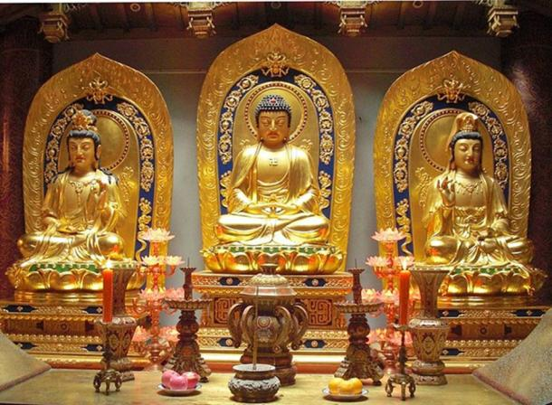 Amitabha Buddha with his attendants Avalokitesvara Bodhisattva, and Mahasthamaprapta Bodhisattva. Hangzhou, Zhejiang province, China.