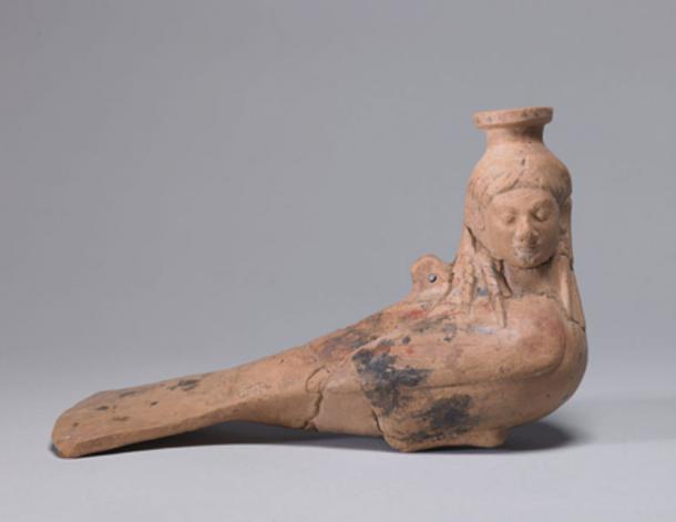 An Archaic perfume vase in the shape of a siren, circa 540 BC