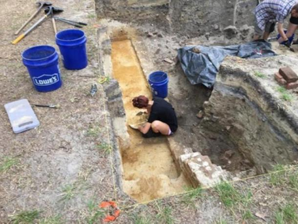 An ECU archaeology student probes the foundations of a probable tavern at Brunswick Town. (Ben Steelman/Starnews)