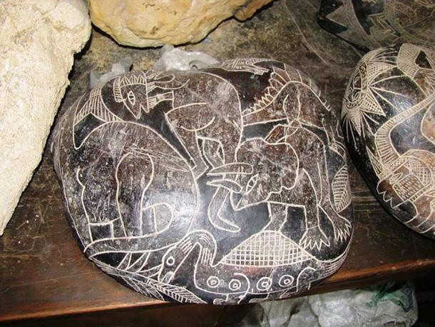 An Ica stone depicting dinosaurs.