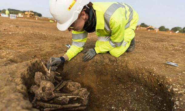 An archaeologist excavates a skeleton in Cambridgeshire.