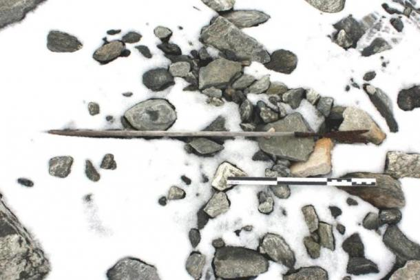An arrow from 800 AD found on the ground in Norway, partly covered by snow. (Espen Finstad, Secrets of the Ice, Oppland County Council)