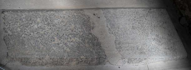 An engraving of a Viking longboat, dating to between 850 and 1050AD can be seen faintly etched into the surface of this stone slab. Credit: Ioannis Syrigos
