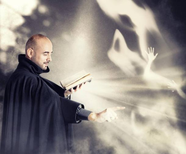 An exorcist banishing demons