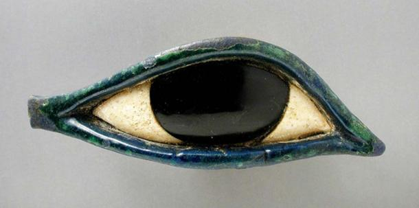 An eye made of glass and obsidian from a coffin belonging to the Late Period (724-333 BC). As an amulet, the popular Wedjat eye symbolized health and protection. Los Angeles County Museum of Art.