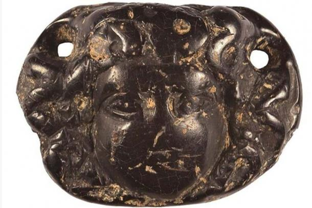 An ornate Roman jet pendant depicting the head of Medusa was found by archaeologists.