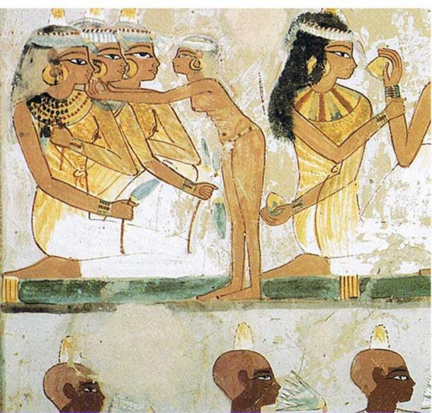 Ancient Egyptian women and men wearing kohl, from the tomb of Nakht in Thebes.