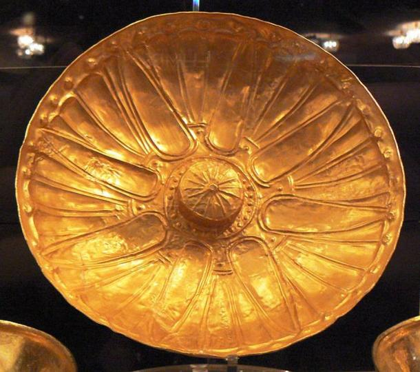 Ancient Greek golden phiale, or vessel with omphalos seen in the center.