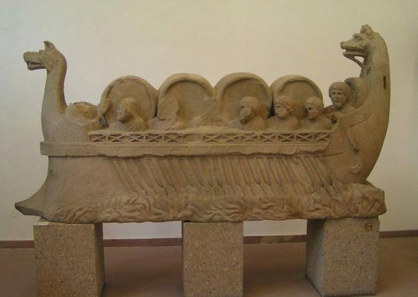Ancient Roman river vessel carrying barrels, assumed to be wine, and people.