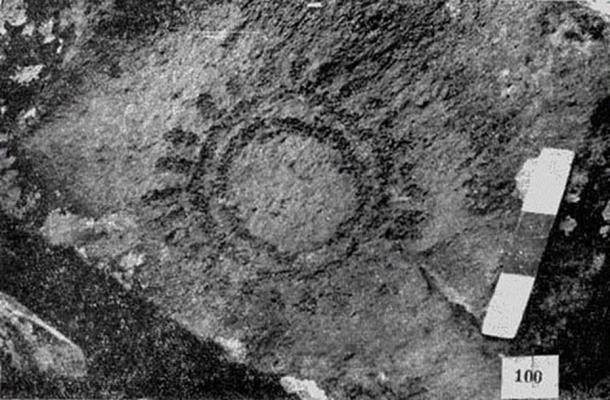 Ancient rock art paintings featuring symbols of lunar and solar events.