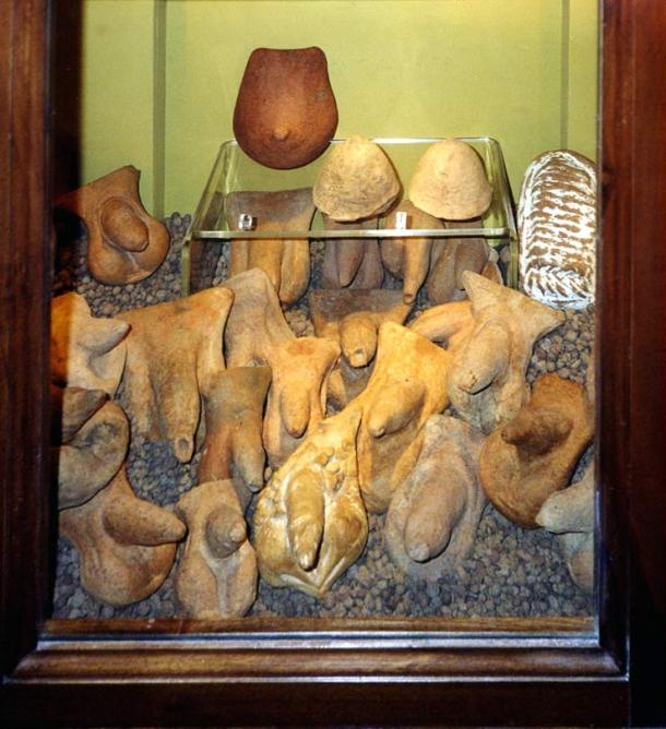 Ancient terracotta sculptures of private parts: penises, a breast and, on the right, a womb at the Museo Archeologico Nazionale of Naples.
