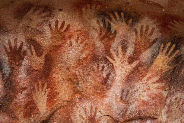 Ancient cave paintings of hands at Cueva de Las Manos in Santa Cruz Province, Patagonia, Argentina. (R.M. Nunes / Adobe Stock)