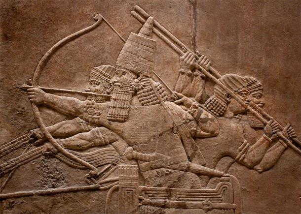 Ancient relief of Assyrian warriors fighting in the war (kmiragaya / Adobe Stock)