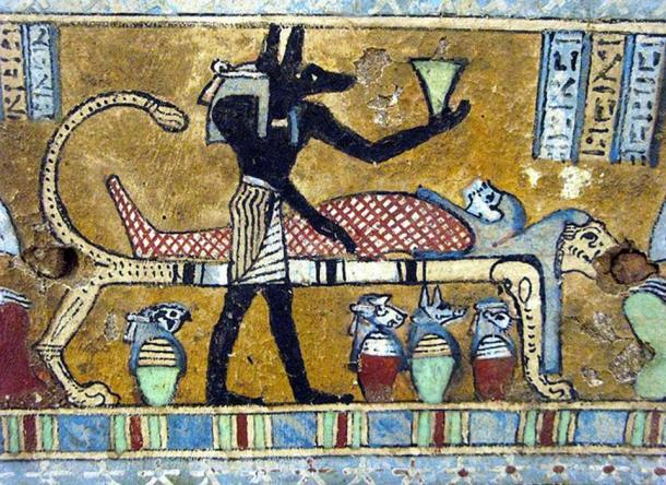 Anubis, supervisor of the mummification process. Underneath the lion bed are the four canopic vases, for the organs that were mummified separately