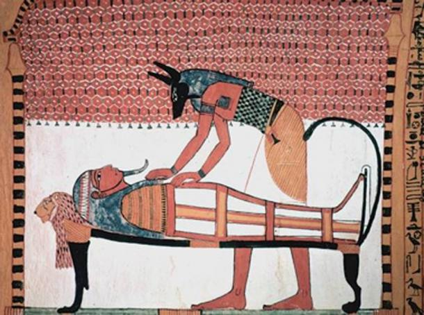 Anubis was the ancient Egyptian god associated with mummification and burial rituals, here he attends to a mummy. (Jeff Dahl / Public Domain)