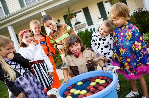 Apple bobbing is a Halloween party game you can still enjoy, as long as you keep it in the family