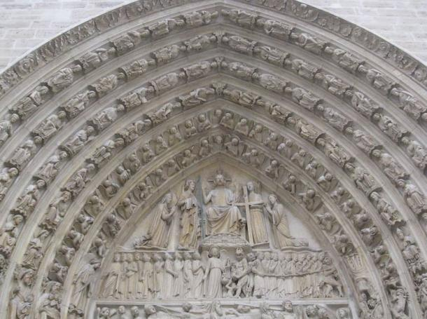 Arch at Notre Dame cathedral, before the fire, shows the elaborate construction and skills of the medieval masons