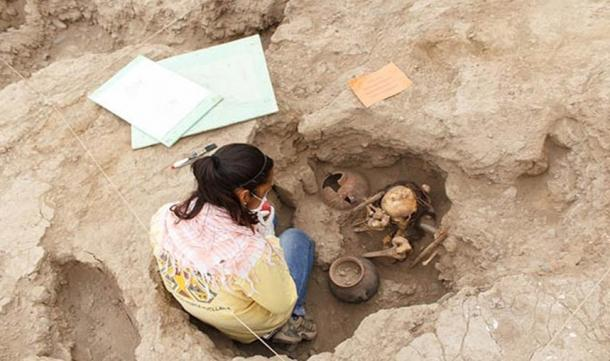Archaeologist Mirella Ganoza examining one of the burials in Lima, Peru.