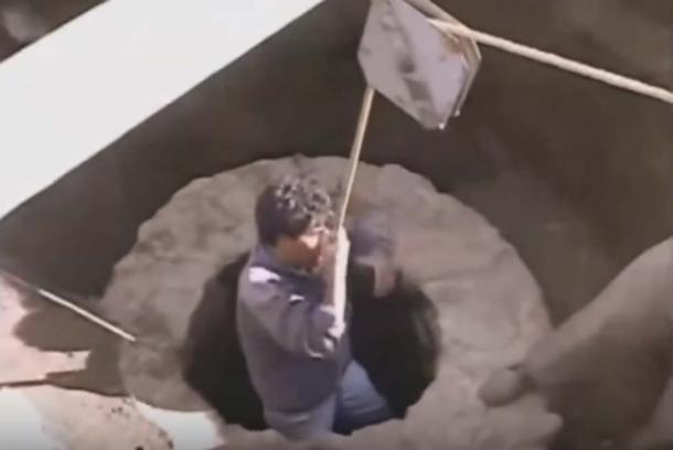 Archaeologist Sergio Gomez is lowered into a perfectly formed stone and cement well shaft that passes underground 14 feet and opens to a deep cavern. At the time of the pyramid's assembly, the shaft may have delivered a combination of water and chemicals which reacted directly underneath the pyramid, delivering its charge to nearby pods. (PBS TV, Teotihuacan's Lost King's. Screenshot via Youtube)